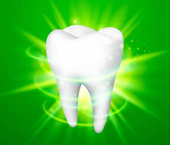 Tooth on a green background